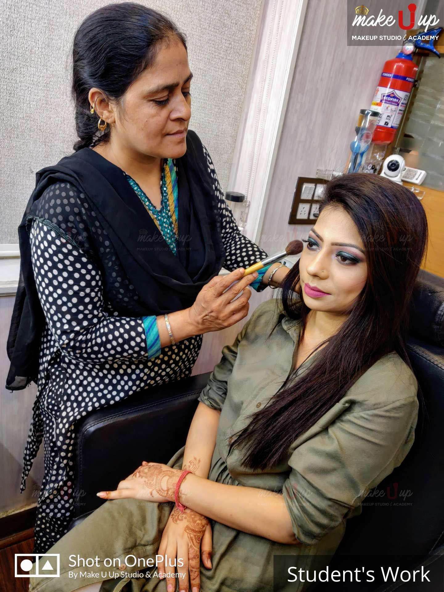 students applying makeup